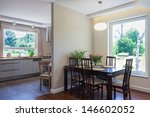 Bright space - an elegant and spacious dining room and kitchen - stock photo