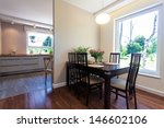 Bright space - a spacious dining room in an elegant house - stock photo