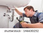 portrait of male plumber fixing ... | Shutterstock . vector #146630252