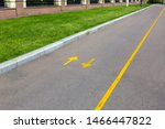 An Asphalt Road With Yellow...