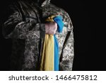 Ukrainian Soldier Holds In His...