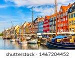 Copenhagen iconic view. Famous old Nyhavn port in the center of Copenhagen, Denmark during summer sunny day.