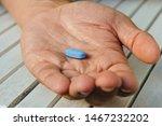 hand of man holding blue pill.... | Shutterstock . vector #1467232202