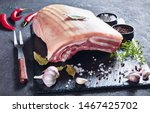 Raw pork belly with skin on a...