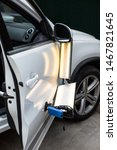 Small photo of Repairing car dent after the accident by paintless dent repair