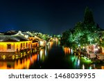 Wuzhen, Zhejiang, China - MAY, 11, 2018 : Night view of The famous and Beautiful water town scenery of West Gate Wuzhen town ancient is a historical and cultural town in Zhejiang CHINA.