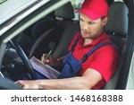 vehicle technical inspection - man sitting inside the car and ch