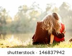 two young women sitting on... | Shutterstock . vector #146837942