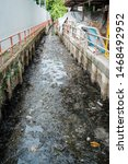 Small photo of Ecology watercourse river canal with garbage and plastic
