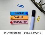 Small photo of Unique Value Proposition - UVP text on sticky notes isolated on office desk