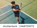 Focused young male tennis...