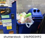 Small photo of Asakusa, Tokyo, Japan - August, 23, 2019 - Blue recycle rubbish bin, garbage can overflowing with plastic pet bottle. Tourists are often confounded by Japan lack of public rubbish bins, garbage cans.