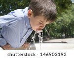 child drinking water from a... | Shutterstock . vector #146903192