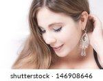 Elegant smiling woman portrait close-up looking down - stock photo