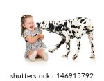 Stock photo child girl playing puppy dog 146915792