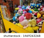 Small photo of May 2019, Drobeta Turnu Severin, Romania. Yellow claw machine situated in Carrefour market. Toys machine full of plushies, Mario plushy, soft toys.