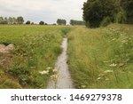 A Ditch Along A Farmland In...