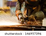 electric wheel grinding on... | Shutterstock . vector #146957396