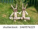 Stock photo decorative hares from tree stumps wooden hares 1469576225