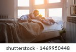 young pretty happy woman laying ...   Shutterstock . vector #1469950448