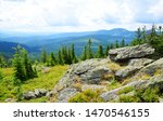 Top of mountain Svaroh in the national park Sumava, Czech Republic. View on the mount Grosser Arber in Bayerische Wald.