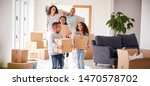 smiling family carrying boxes... | Shutterstock . vector #1470578702