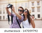happy tourists taking photo of... | Shutterstock . vector #147059792