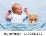 Stock photo baby sleeping with kitten on blue knitted blanket child and cat kids and pets newborn kid with 1470601832