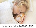 Stock photo baby boy sleeping with kitten on white knitted blanket child and cat kids and pets little kid 1470601955