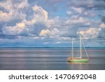 Sailboat Motoring Along Calm...