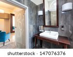 Countertop and sink in classic bathroom - stock photo