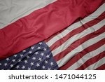Stock photo waving colorful flag of united states of america and national flag of poland 1471044125