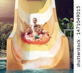 Small photo of European boy and mother slides down water slider on floater at waterpark.