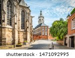 Cobbled Street With Church And...