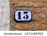 Stock photo a tile on a wall displaying the number 1471185902