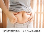 Small photo of Fat woman, Fat girl, Fat belly, Chubby, Overweight fatty belly of woman isolated on white and brown background, Woman diet lifestyle concept to reduce belly and shape up healthy stomach muscle.
