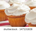 Vanilla Cupcakes On A Red And...
