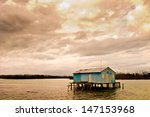 fishermen houses over water ... | Shutterstock . vector #147153968