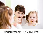 mother teaching kid teeth... | Shutterstock . vector #147161495