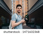 handsome man in t shirt holding ... | Shutterstock . vector #1471632368