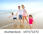 Happy Family Running On The...