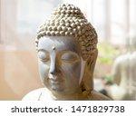 Sunlit Statue Of Buddha. Close...