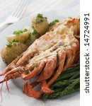 Small photo of Half a Lobster Thermidor with New Potatoes and Asparagus Spears