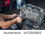Diesel engine during service repair by a qualified mechanic - stock photo