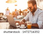 young man at cafe working on... | Shutterstock . vector #1472716352