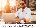 young man at cafe working on... | Shutterstock . vector #1472716355