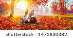 happy couple enjoying the fall... | Shutterstock . vector #1472830382