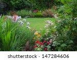 view of a lush backyard lawn... | Shutterstock . vector #147284606
