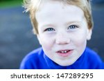 portrait of a happy young boy. | Shutterstock . vector #147289295