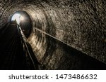 Small photo of Narrowboat with headlight travelling through the Chirk Tunnel on the Llangollen canal